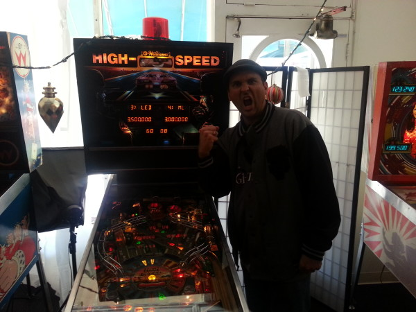 Ryan Williams in front of a High Speed Pinball Machine